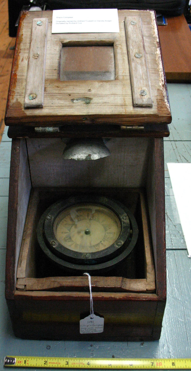 Boat compass in wooden binnacle box used by Wilfred S. Trussell  and Harvey Everett Bulger
