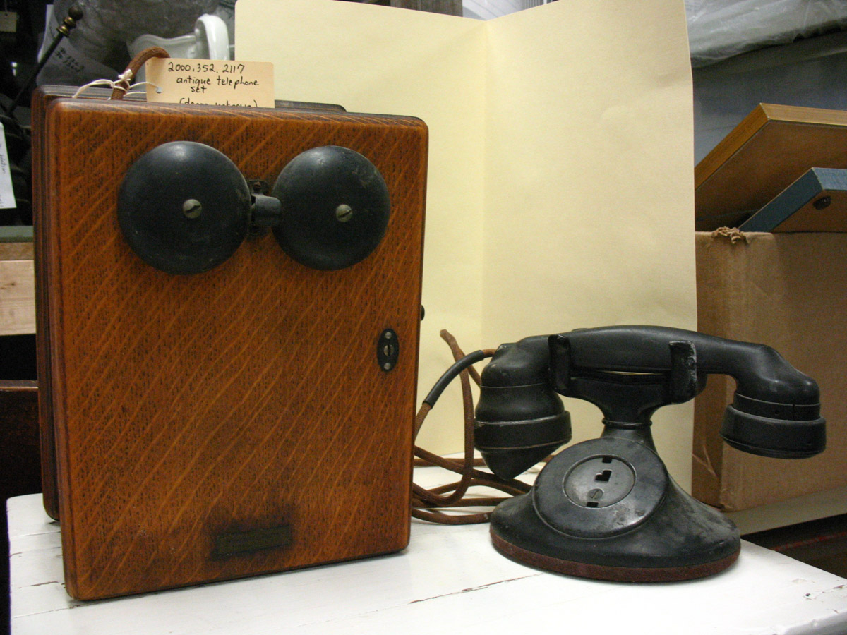 Antique telephone with wooden box and hand crank