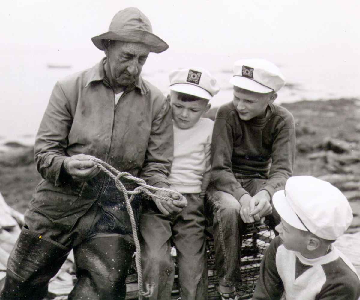"""Captain Charles """"Pink"""" Stanley teaching knot tying to the Williams brothers"""